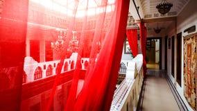 O vermelho diáfano drapeja em um corredor foto de stock royalty free