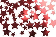 O vermelho do feriado stars o fundo isolado Foto de Stock
