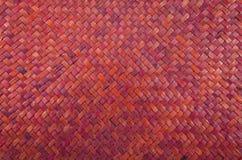 O vermelho handcraft o vime natural da textura do weave Imagem de Stock Royalty Free