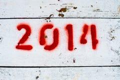 O vermelho numera 2014 na superfície do branco Fotos de Stock Royalty Free
