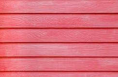 O vermelho pintou o fundo de madeira da textura da placa do cimento da fibra da grão Fotos de Stock