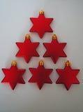 O vermelho stars a árvore de Natal Foto de Stock