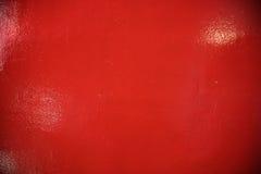 O vermelho sujo marmoreou concreto com nervuras o fundo pintado da parede Fotos de Stock