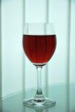O vidro com vermelho Foto de Stock Royalty Free