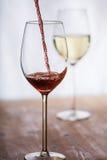 O vinho encheu-se em um vidro Fotos de Stock Royalty Free