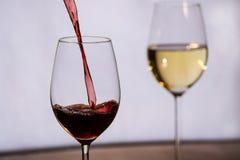 O vinho encheu-se em um vidro Imagens de Stock Royalty Free