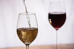 O vinho encheu-se em um vidro Fotografia de Stock