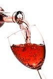 O vinho vermelho derrama Fotos de Stock