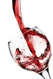 O vinho vermelho derrama no vidro Foto de Stock Royalty Free