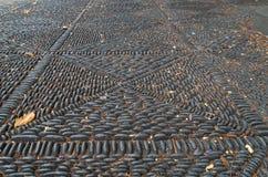 O vintage cobbled o assoalho com um teste padrão bonito, La Palma da plaza Fotografia de Stock