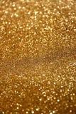 O vintage do brilho ilumina o fundo Fundo abstrato do ouro defocused Fotos de Stock