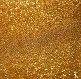 O vintage do brilho ilumina o fundo Fundo abstrato do ouro defocused Imagem de Stock