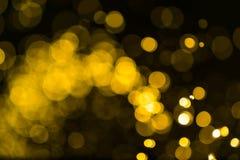 O vintage do brilho ilumina o fundo ouro escuro e preto defocuse imagem de stock royalty free