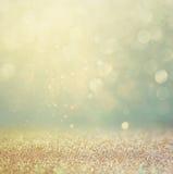 O vintage do brilho ilumina o fundo ouro, prata, azul e preto de-focalizado Fotografia de Stock