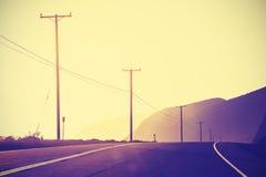 O vintage tonificou o por do sol na estrada pacífica, Califórnia, EUA Imagens de Stock Royalty Free