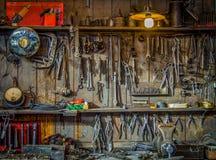 O vintage utiliza ferramentas a oficina Foto de Stock