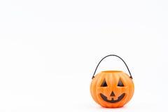 O& x27 de Jack; plástico del pumpkinhead de la linterna en el fondo blanco usado para Foto de archivo libre de regalías