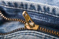 O zíper dourado imagens de stock royalty free