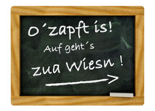 O´zapft is!. Black board with a pine frame for Oktoberfest Stock Images
