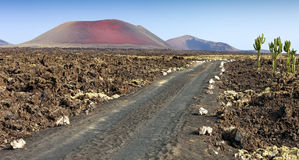 Oad leading to the mountains of fire, Timanfaya Stock Photography