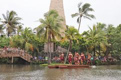 Oahu, Hawaii - 4/26/2018 - Hawaiian dancers performing while riding a canoe float at the Polynesian Cultural Center in Hawaii stock images