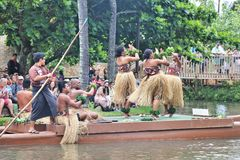 Oahu, Hawaii - 4/26/2018 - Hawaiian dancers performing while riding a canoe float at the Polynesian Cultural Center in Hawaii royalty free stock photography
