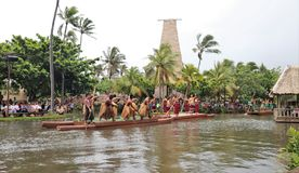 Oahu, Hawaii - 4/26/2018 - Hawaiian dancers performing while riding a canoe float at the Polynesian Cultural Center in Hawaii stock photography