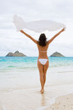 Oahu woman beauty. Woman with sarong blowing in the wind on lanikai beach hawaii Royalty Free Stock Photos