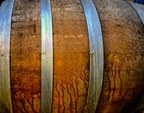 Oak barrel for fermenting beer. Steel metal hoops encircle oak barrel used for fermenting beer Stock Images