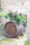 Oak barrel and flowers Royalty Free Stock Photos