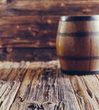 Oak barrel on old wooden table stock photography
