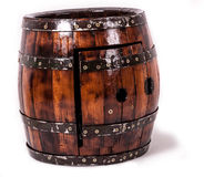Oak barrel table. Barrel table with door and bottles of brandy inside Royalty Free Stock Images