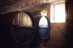 Oak barrels in an historic wine cellar of piedmont Italy stock images