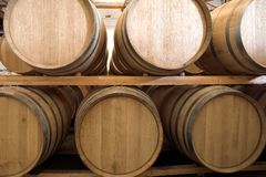 Oak barrels maturing red wine Stock Photos