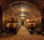 Oak barrels in a underground wine cellar Stock Image