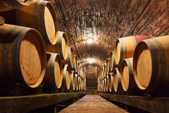 Oak barrels in a underground wine cellar Stock Photography