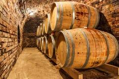 Oak barrels in a underground wine cellar Stock Photo