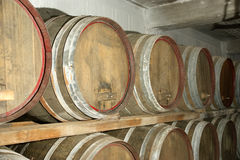 Oak barrels in which the wine matures at a winery Royalty Free Stock Photography
