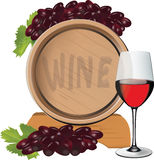 Oak barrels for wine. With glass and bunch of grapes Stock Photo