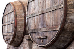 Oak barrels in a winery, brewery or distillery. Large oak barrels in the cellars of a winery, brewery or distillery for the storage, fermentation or ageing of stock photo