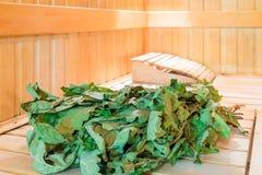 Oak bath broom lying Stock Photos