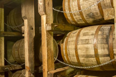 Oak bourbon barrels on rack in warehouse Royalty Free Stock Images
