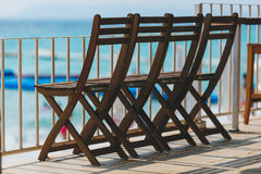 Oak chairs on the beach Royalty Free Stock Photo