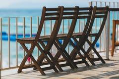 Oak chairs on the beach Stock Photo