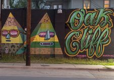 Oak Cliff mural by sourgrapes along Davis Avenue, Bishop Arts District, Dallas. Pictured is a whimsical mural along Davis Avenue in the Bishop Arts District royalty free stock image