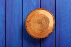Oak cracked split on navy blue wooden table Stock Image