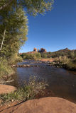 Oak Creek and Cathedral rock near Sedona. Wide angle shot from close to the ground over river towards the famous rock formation Stock Image