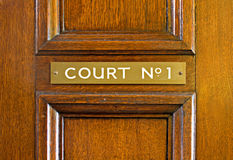 Oak door leading into court Royalty Free Stock Photography