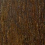 Oak grain veneer texture background, dark black brown natural vertical scratched textured pattern, large detailed rugged wood macr Royalty Free Stock Images