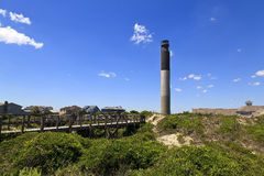 Oak Island Lighthouse. Lighthouse is located on Caswell Beach, North Carolina.  Built in 1958, 148 foot tall beacon Stock Photos